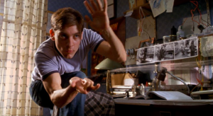 2002-Rami-Maguire-Spider-man-movie-Tobey-Maguire-short-hair-cut-slinging-webs-590x323
